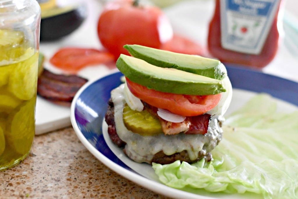 ultimate keto burger with cheese bacon avocado tomato and onion