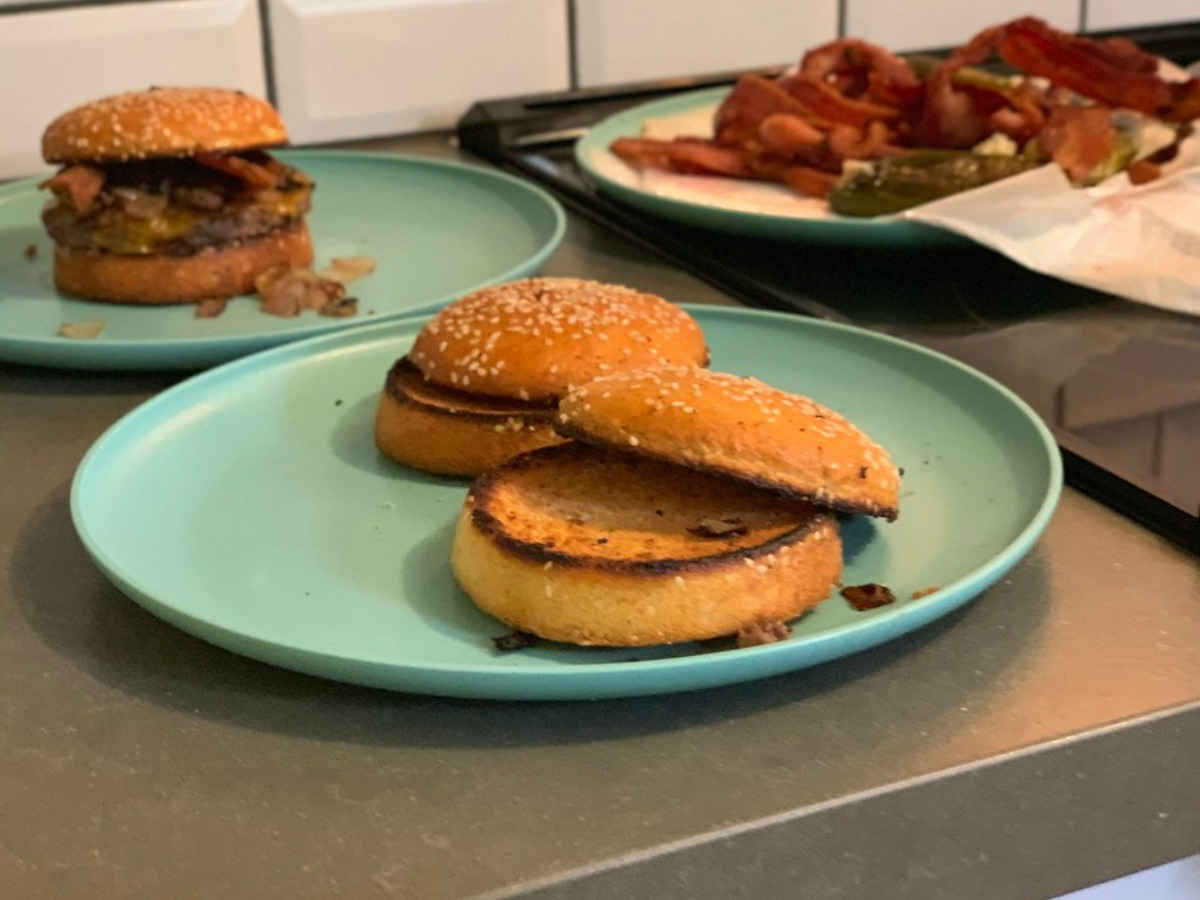 Smartbuns toasted on plates and ready for burgers