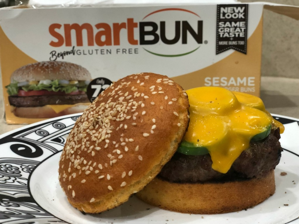 SmartBun package sitting behind cheeseburger on keto sesame bun