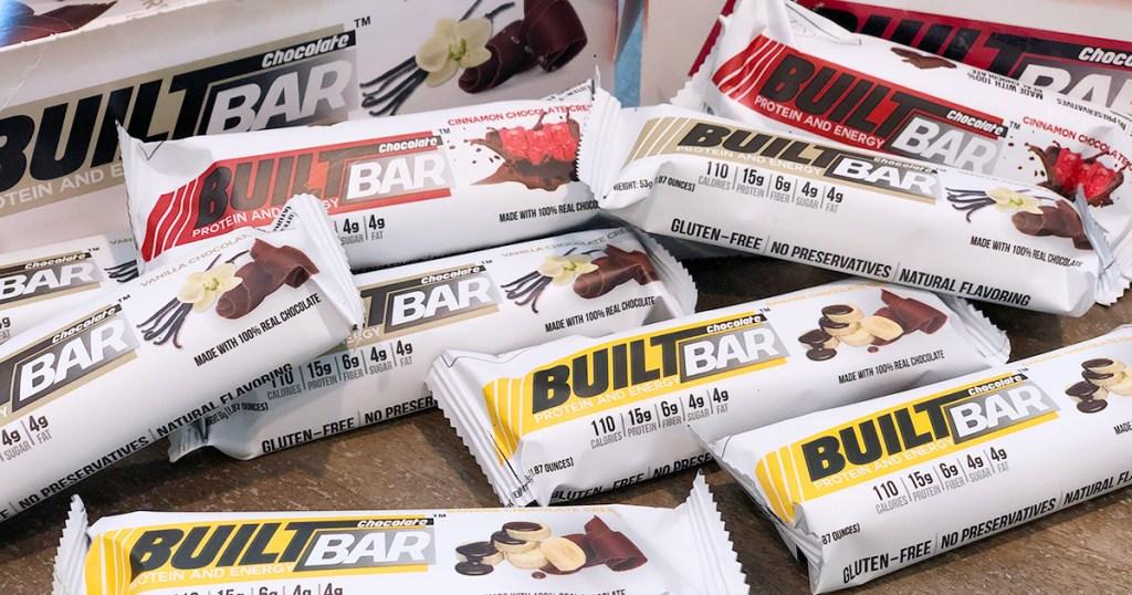 assortment of flavors of built bars
