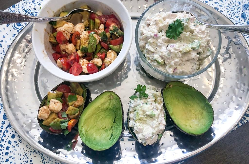 arrangement of caprese salad and chicken salad avocado boats