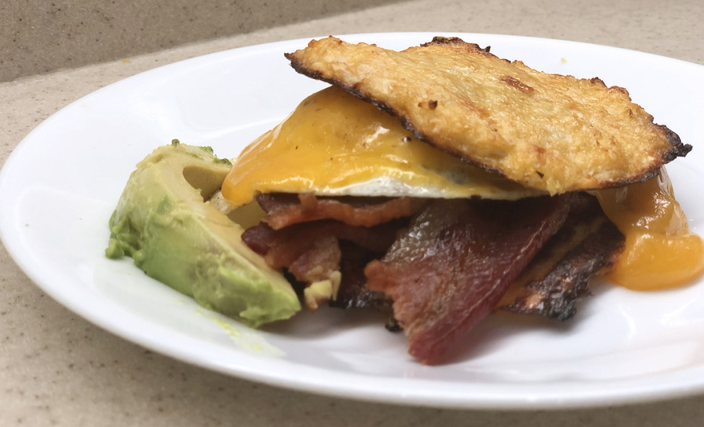 breakfast sandwich made with keto cauliflower english muffins
