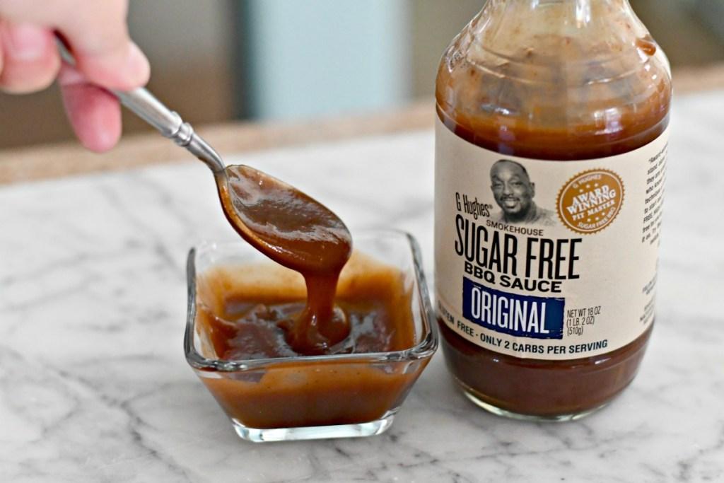 g hughes bbq sauce on a spoon