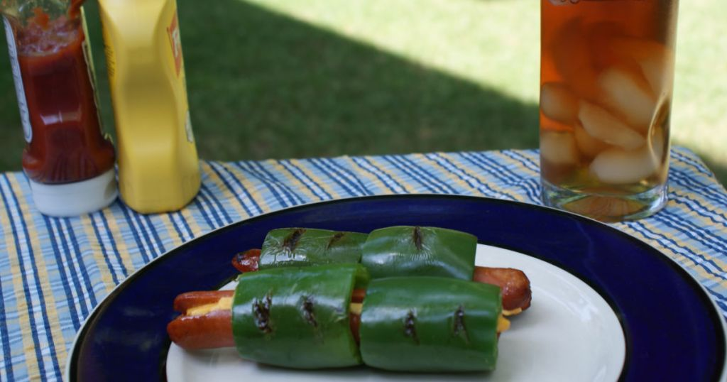 jalapeno stuffed hot dog with cheese on plate served ready to eat
