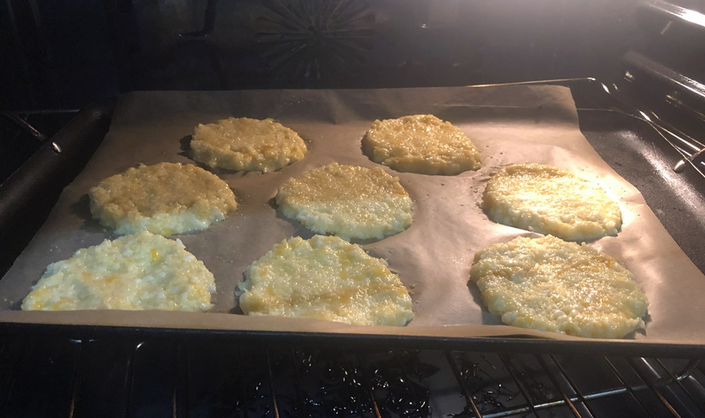 keto cauliflower english muffins on tray in the oven