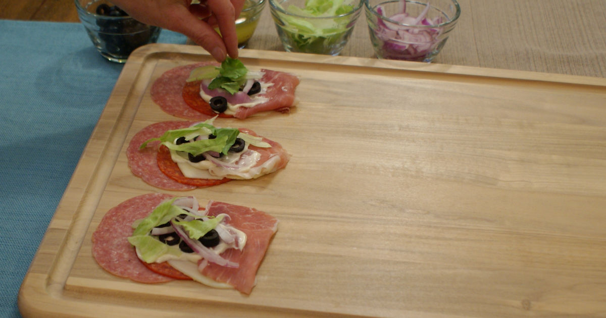 adding toppings to the roll-ups
