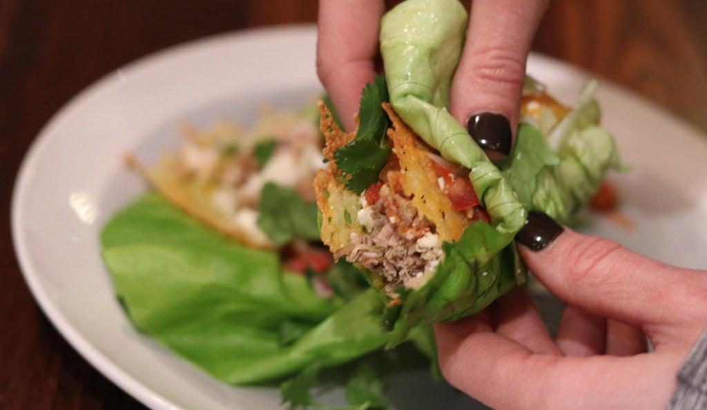 holding lettuce taco wrap