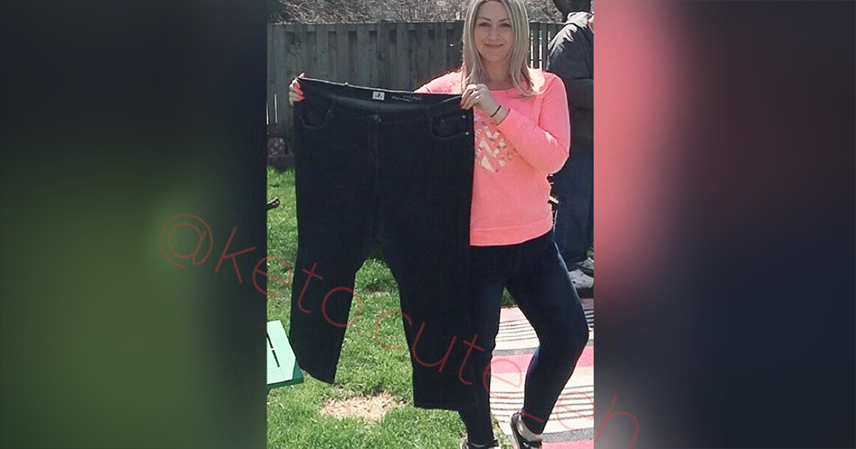 sarah holding up larger jeans showing keto weight loss