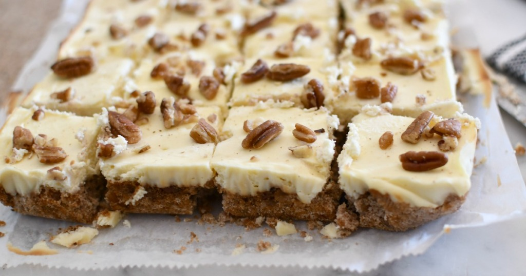sliced keto pecan cheesecake bars on parchment paper
