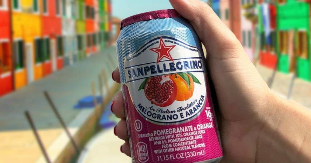 hand holding San Pellegrino sparkling water can