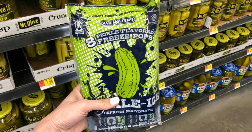 hand holding Van Holten's pickle freeze pops at Walmart