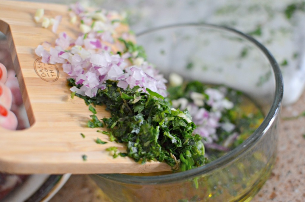 chopping ingredients for chimichurri sauce