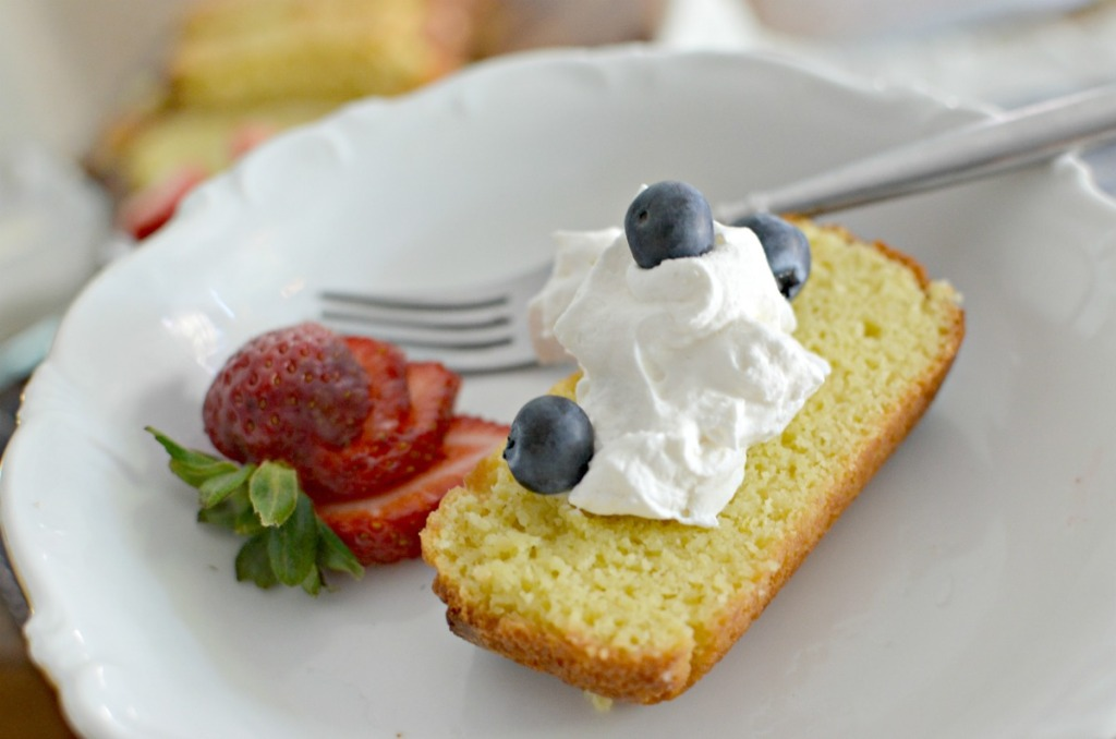 keto pound cake served on a plate with whipped cream
