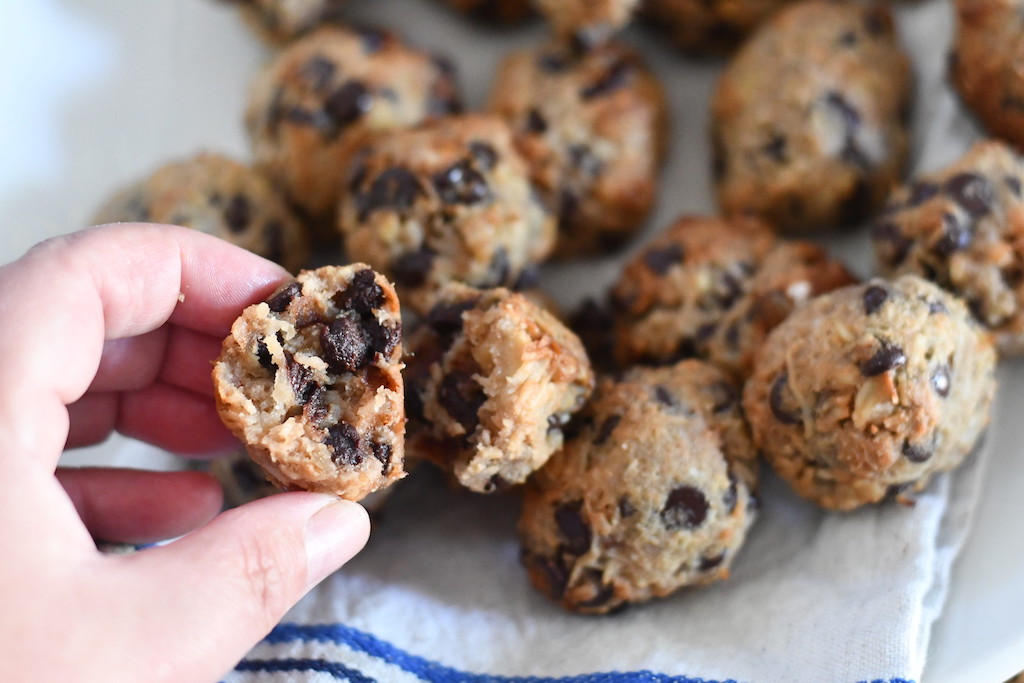 holding keto coconut cookies with chocolate chips