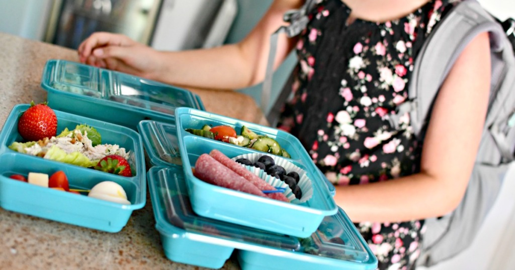 girl packing a keto lunch for school