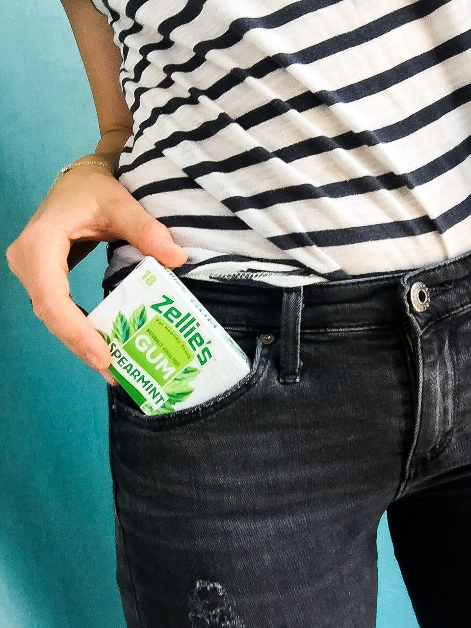pulling pack of Zellie's gum from jeans pocket