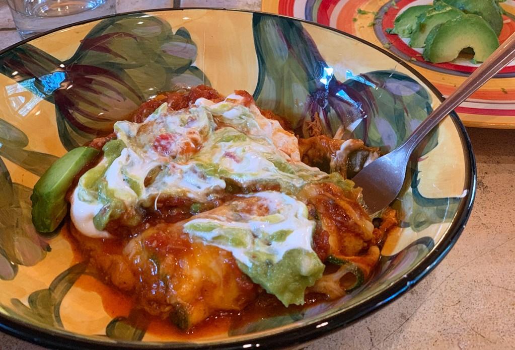 keto zucchini enchilada with sour cream and guacamole