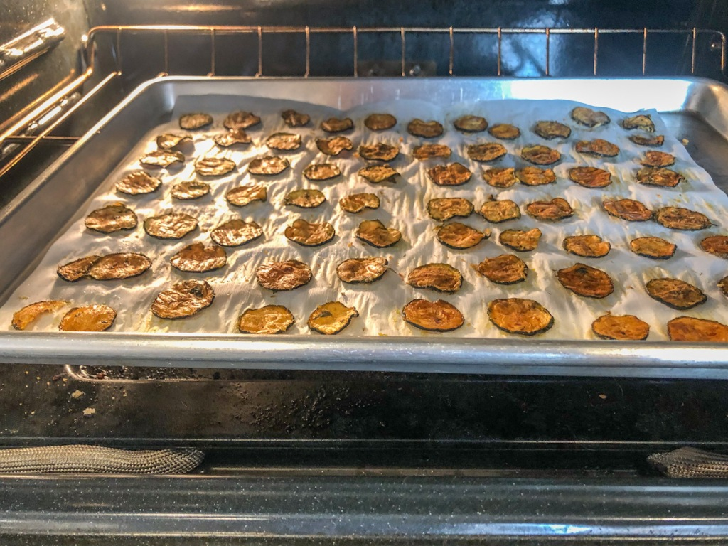keto zucchini chips on a baking sheeting the oven
