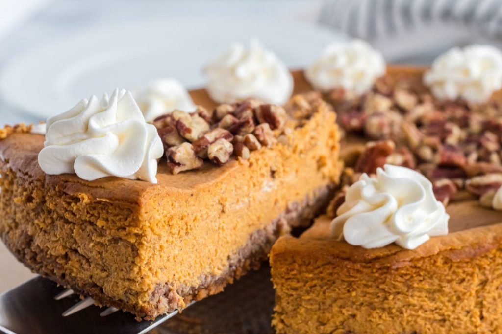 slice of pecan pumpkin pie topped with whipped cream