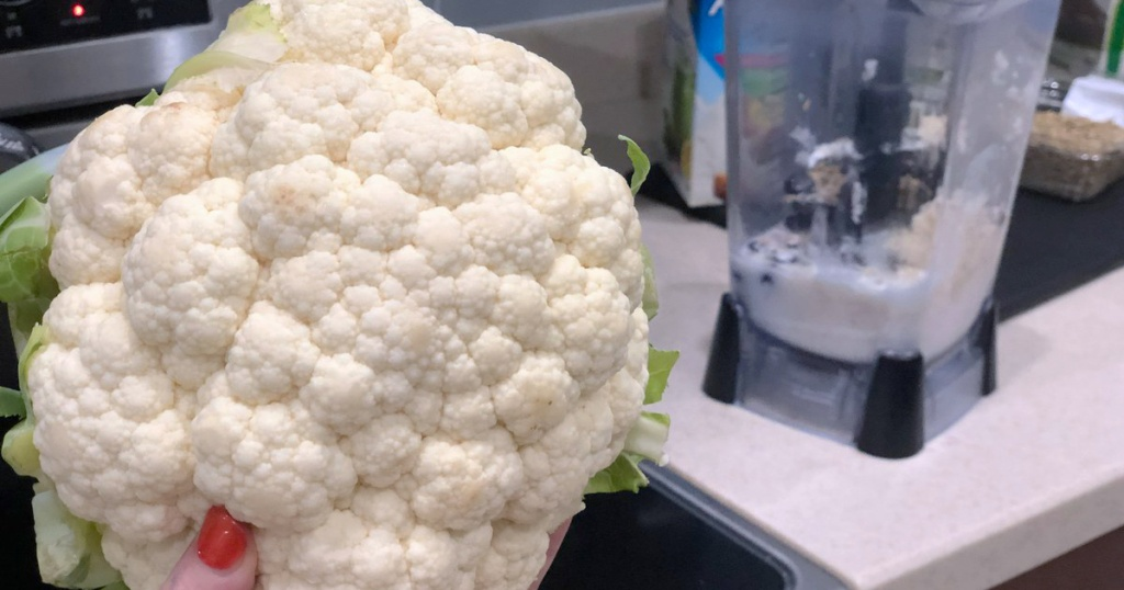 cauliflower head in front of blender
