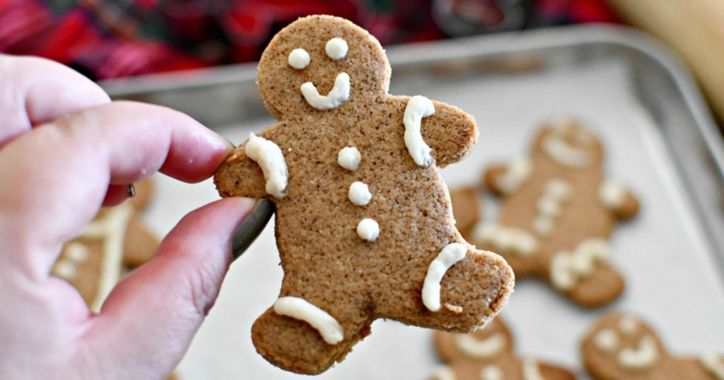 holding up a keto gingerbread cookie