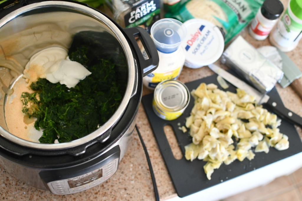 instant pot on counter with artichoke dip