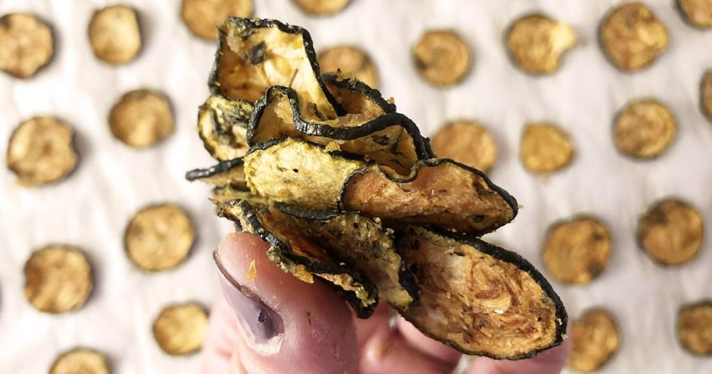 keto zucchini chips in hand