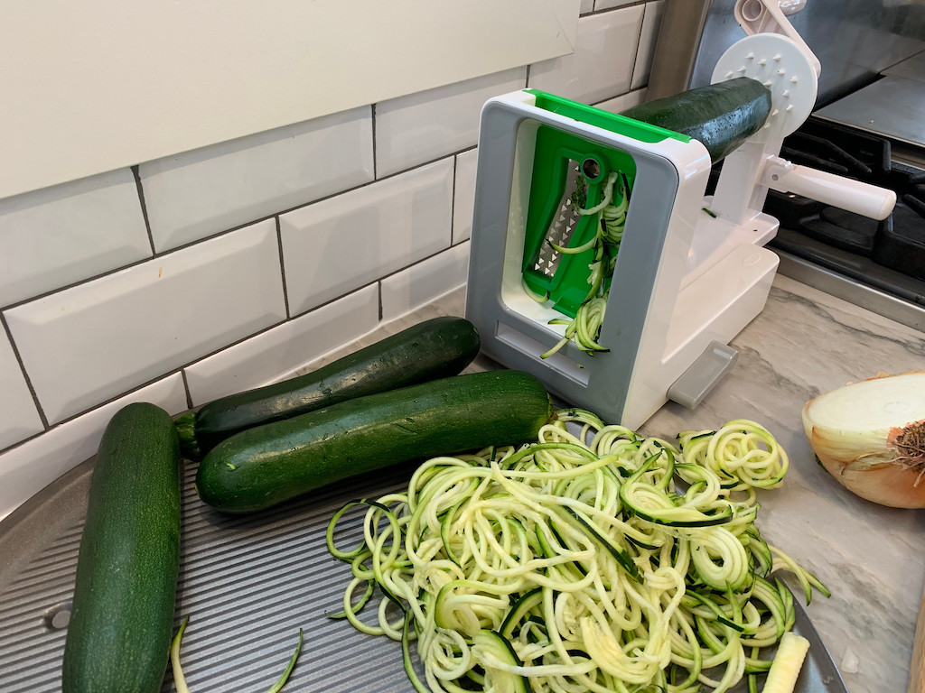 making lots of zoodles with OXO countertop spiralizer