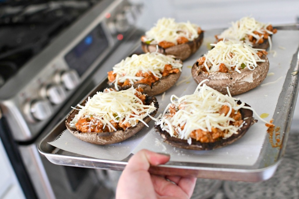 pan of keto stuffed mushrooms going into the oven