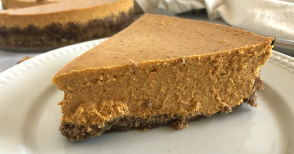 slice of keto pumpkin cheesecake on plate