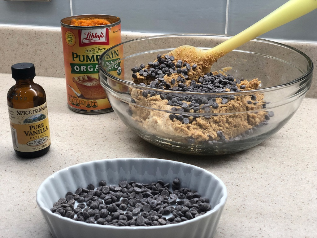 mixing in chocolate chips into keto pumpkin cookie dough