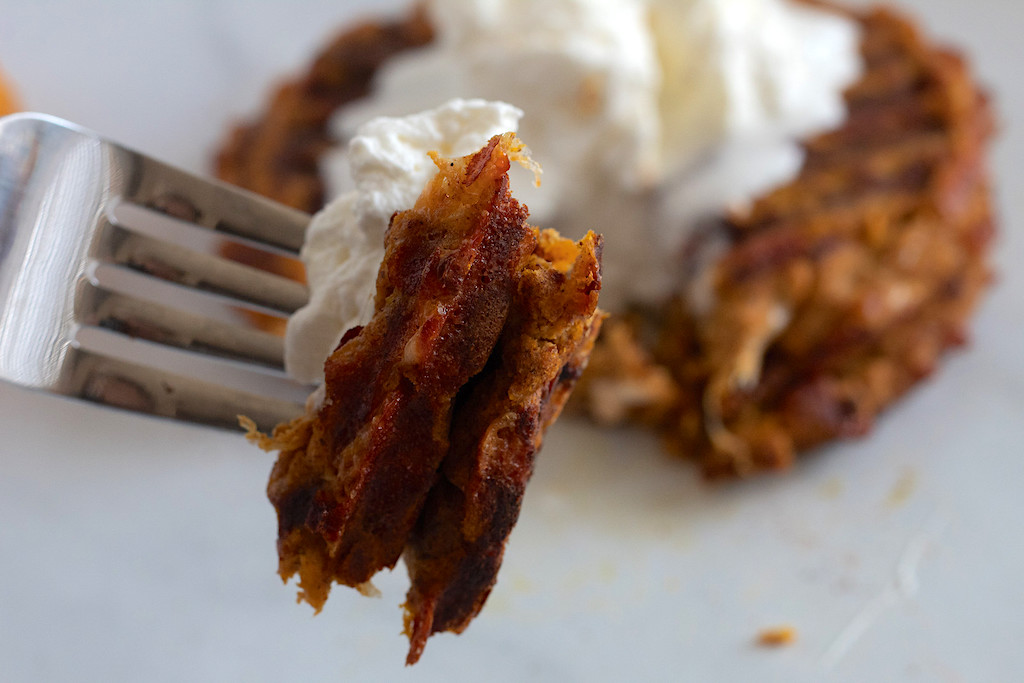 fork with keto pumpkin spiced chaffle and whipped cream