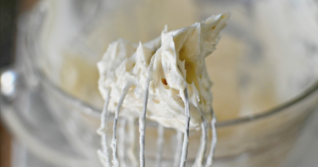 vanilla keto frosting on a whisk
