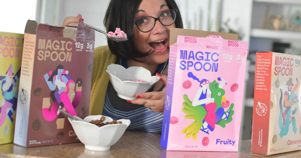 woman eating Magic Spoon keto cereal with cereal boxes around her
