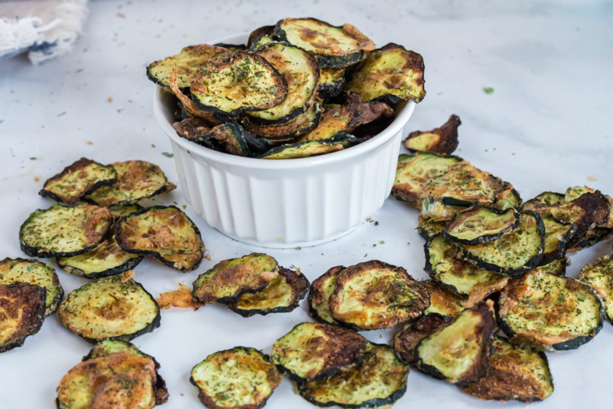 zucchini chips on parchment paper after cooking