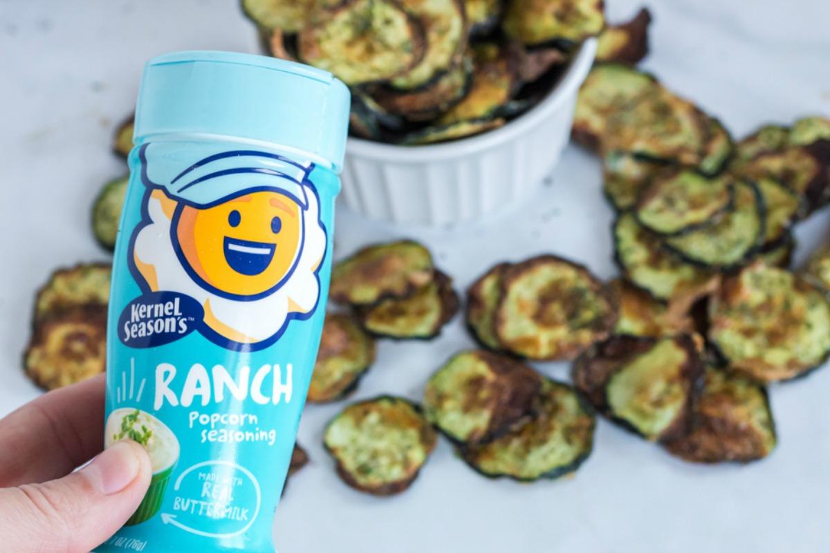 zucchini chips behind Ranch popcorn seasoning