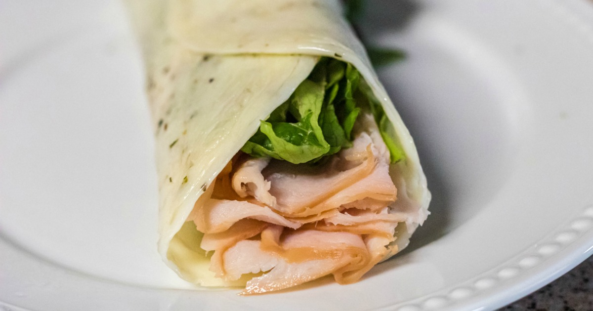 Keto Cheese Wrap with lettuce and turkey on plate