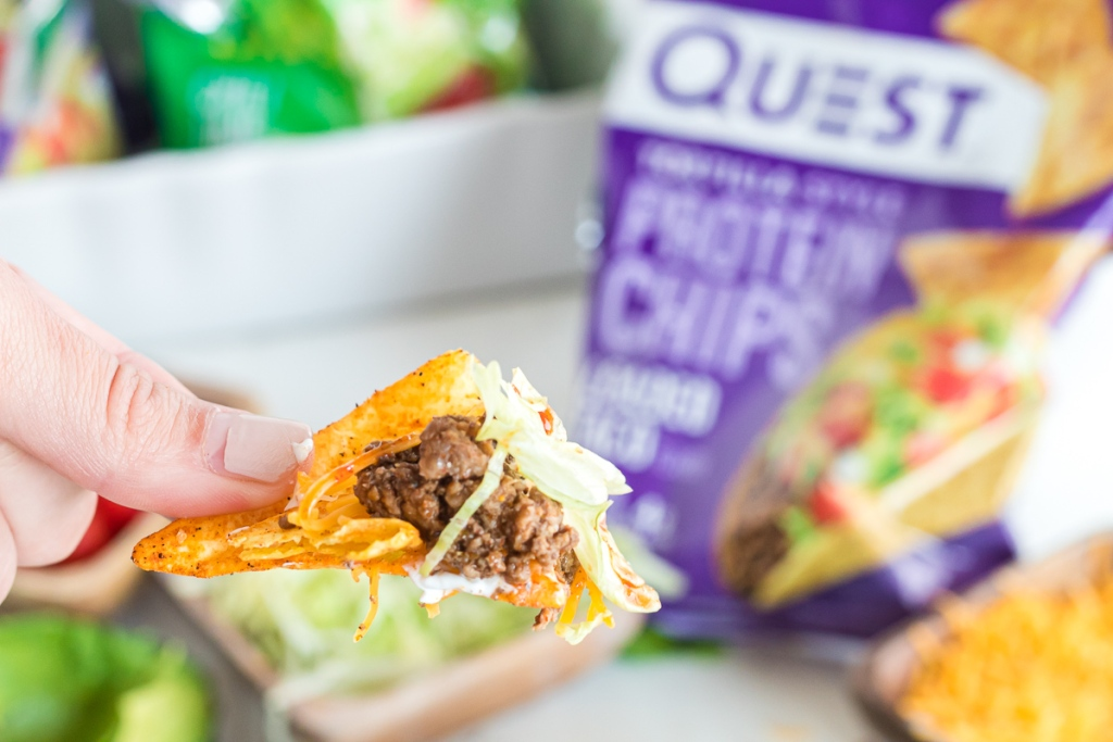 Quest chip with taco toppings on it