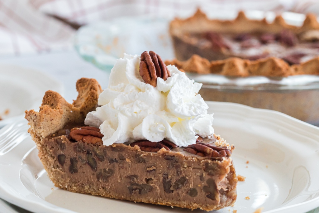 slice of pecan pie with whipped cream