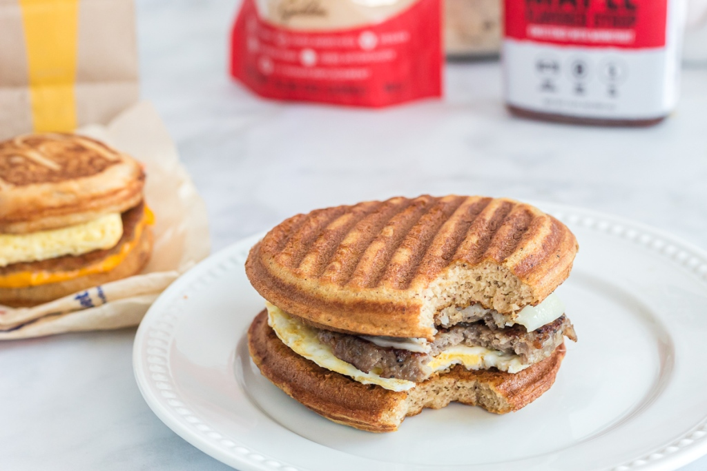 keto sausage mcgriddle with bite taken out