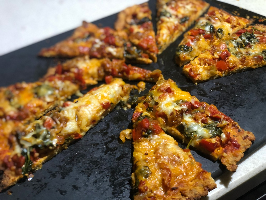 Slices of sausage crust pizza