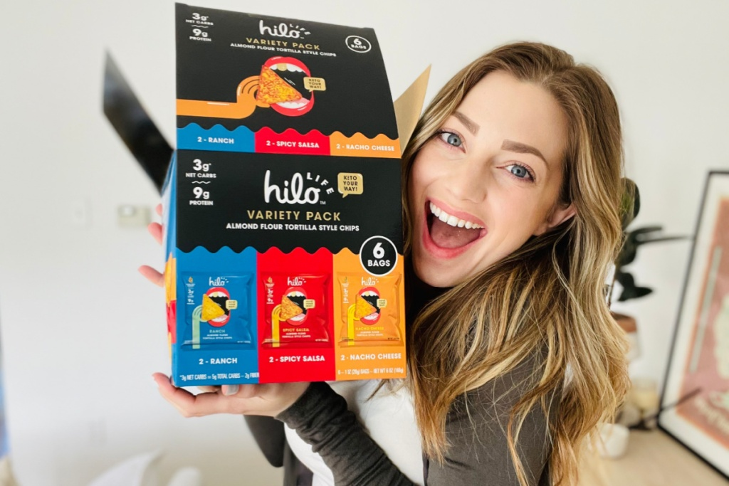 woman holding hilo tortilla chip variety pack