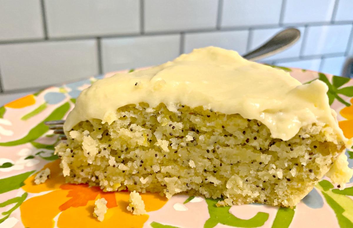 slice of keto lemon poppyseed cake using swerve cake mix