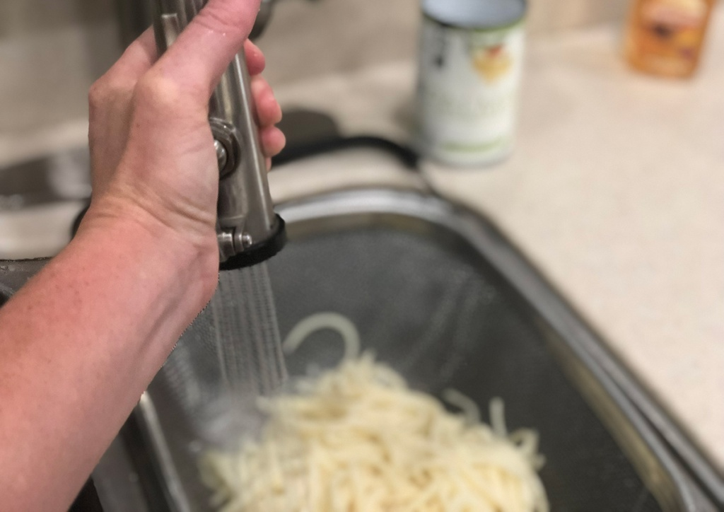 Rinsing Palmini hearts of palm pasta