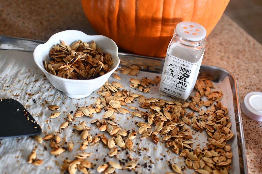 roasted and seasoned pumpkin seeds on pan