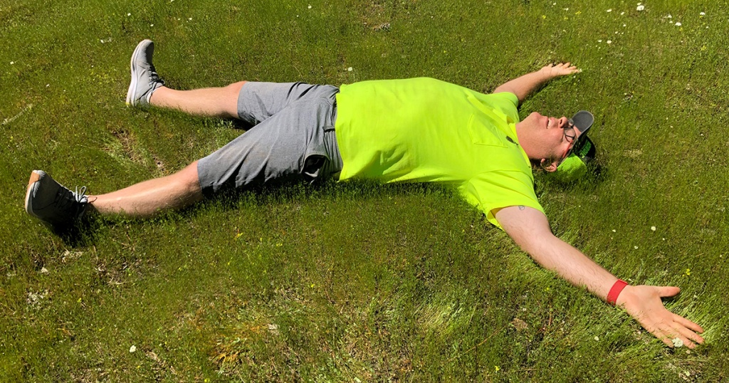 man laying on grass