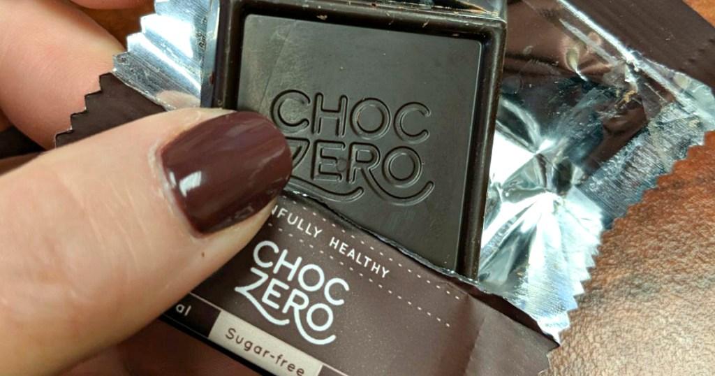 holding ChocZero candy square