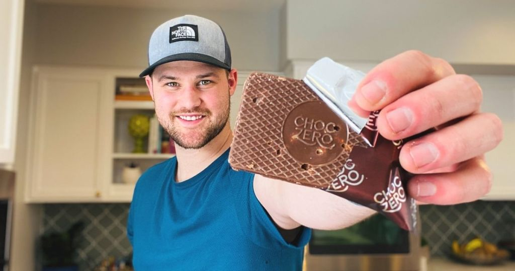 A man holding a chocolate keto bark dessert