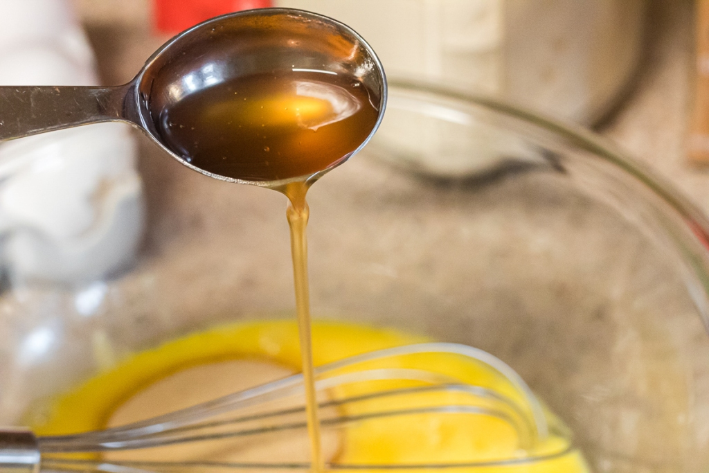 pouring syrup into egg mixture