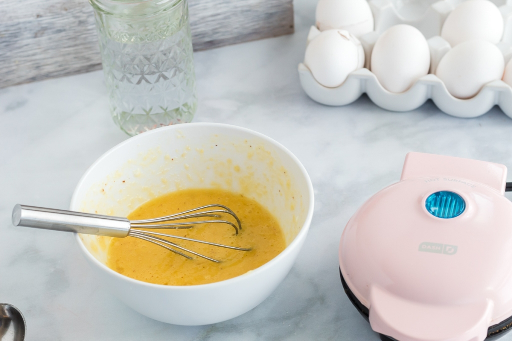 dash maker and bowl of egg mix